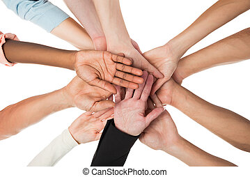 Creative Business Team Piling Hands - Directly below shot of...