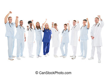 Multiethnic Medical Team Standing With Arms Raised - Full...
