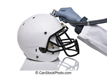 Football Concussion Concept - A football helmet and doctors...
