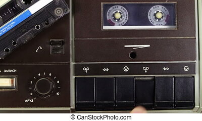 Cassette Tape Deck - Vintage tape recorder plays the tape...
