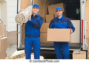 Happy Delivery Men Carrying Cardboard Box And Carpet -...