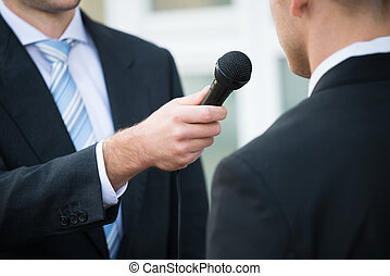 Journalist Taking Interview Of Businessman