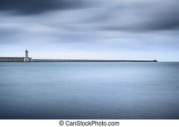 Livorno port lighthouse, breakwater and soft water under...