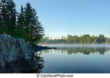 Morning Reflections on a Foggy Wilderness Lake - Morning...