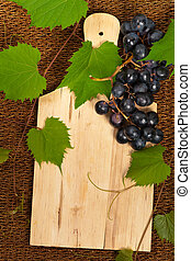 Grape with vine leaves