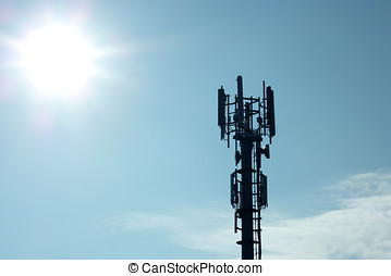 Transmitter mast - Silhouette of transmitter tower showing...