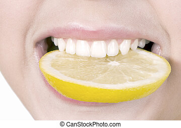 Lemon in a teeth - Segment of lemon at the girl in teeth,...