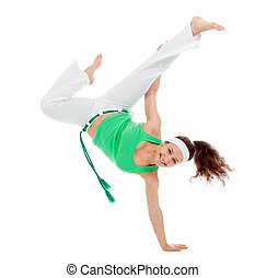girl capoeira dancer posing over white background