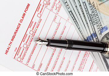 health insurance claim form with fountain pen