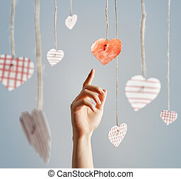 valentin paper hearts - Man's hand reaching for paper...
