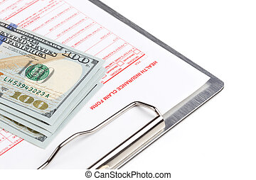 health insurance claim form on the clipboard with money
