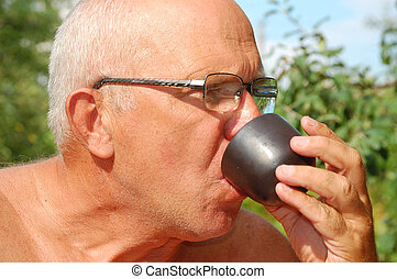 senior man drinking tea outdoor