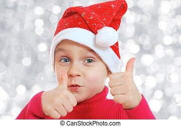 Santa girl - happy Christmas child with thumds up
