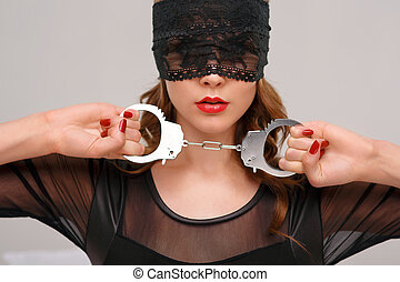 Sexual woman holding handcuffs - Beauty and handcuffs...