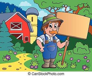 Farmer with sign near farm