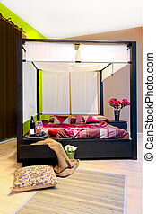 Canopy bedroom - Interior of bedroom with big canopy bed
