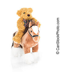 Teddy bear riding a horses on white background