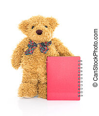 Teddy bear with pen and blank red notebook