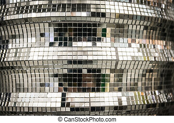Background formed by a coating of little mirror pieces that...