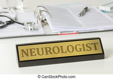 Name plate on a desk with the engraving Neurologist