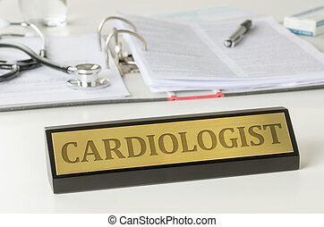 Name plate on a desk with the engraving Cardiologist