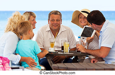 Nice pictures of their family on vacation - Woman with...