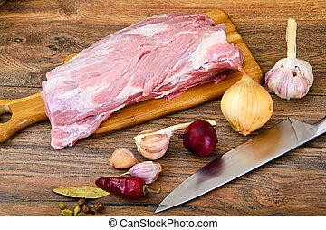 Raw Pork on a Cutting Board