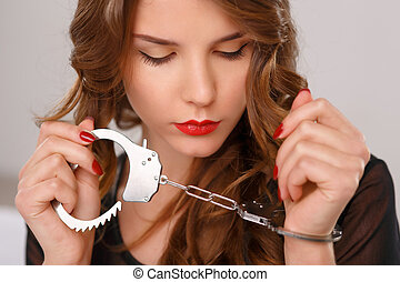 Appealing young girl posing with handcuffs - Locked in cuffs...