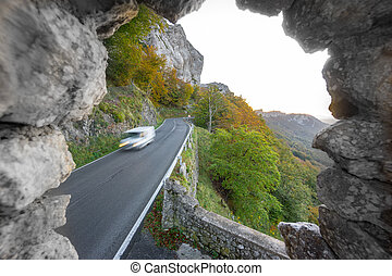 Van driving down mountain with curved road - Blurred van...