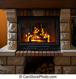 close up of burning fireplace at home - heating, warmth,...