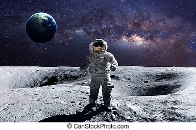 Brave astronaut at the spacewalk on the moon. This image...
