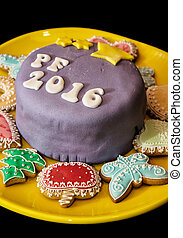 Detail of festive cake with the title PF 2016 and various...