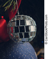 Silver toy on Christmas tree