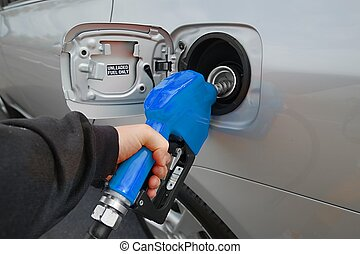 Fuel Nozzle - Fuel nozzle with hose isolated on white...