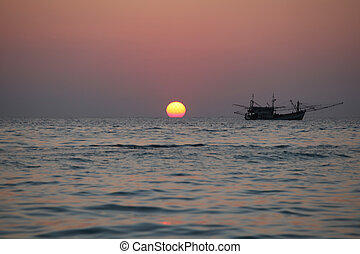 Fishing boat at sunset in Thailand