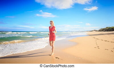 Blond Slim Girl in Red Runs along Surf Circles Barefoot -...