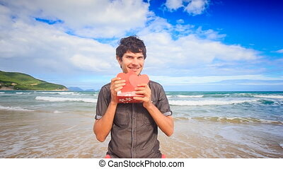 Guy Holds Shows Red Hearts Gift on Wave Surf Beach Smiles -...