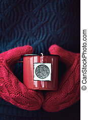 Mug of tea in woollen mittens - Mug of tea held in woollen...