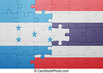 puzzle with the national flag of honduras and thailand...