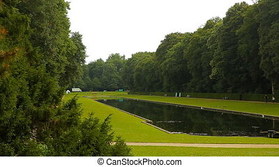 A beautiful artificial lake, surrounded by greenery -...