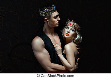 Girl in the arms of a man. On their heads they crown.