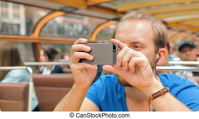 Hipster tourist is taking pictures of European sights - A...