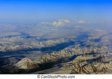 Flying from Fairbanks to Anchorage, shooting in airplane -...