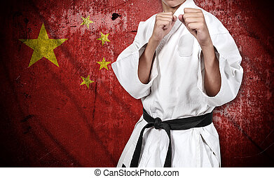 karate fighter in kimono and china flag - karate fighter in...