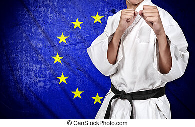 karate fighter and european union flag - karate fighter in...
