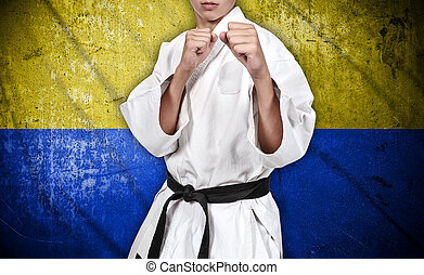 karate fighter and ukraine flag - karate fighter in white...