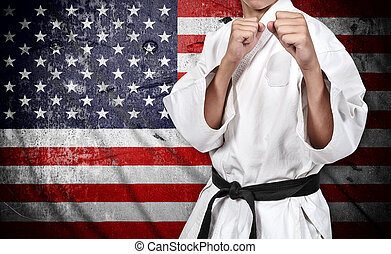 karate fighter and american flag - karate fighter in kimono...