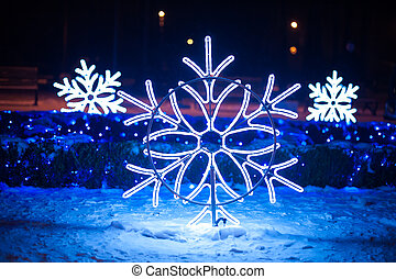 Christmas illuminations in the form of snowflakes in the...