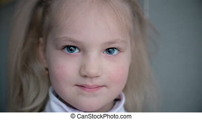 Portrait of a 5 year-old child who smiles HD