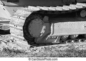 bulldozer tracks in black and white - detail of track and...